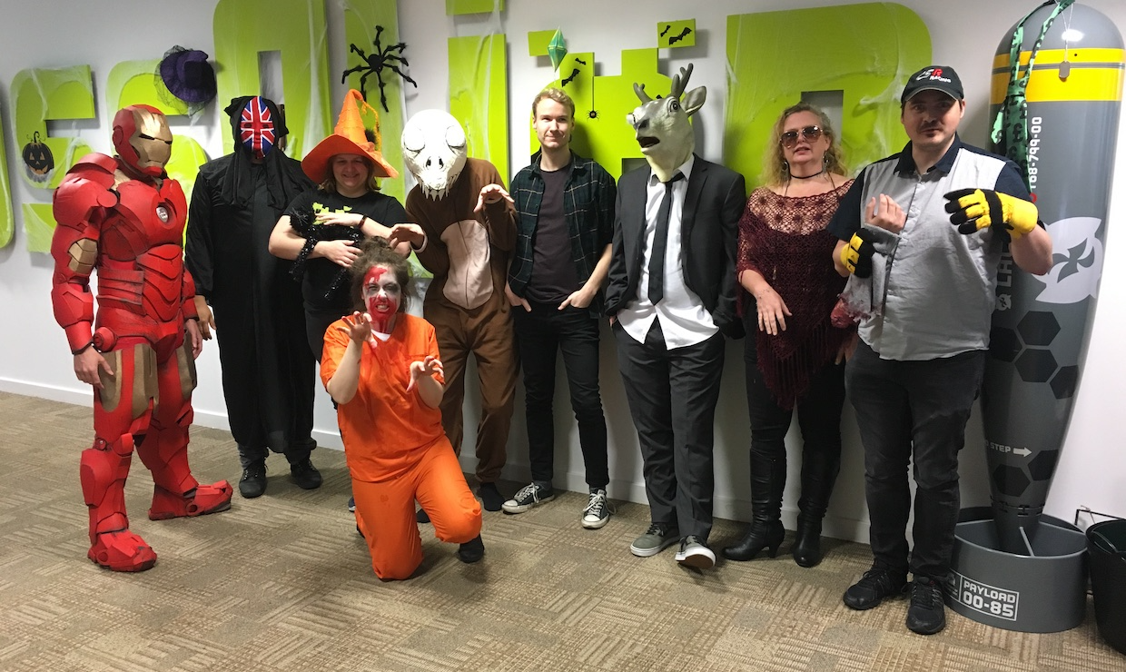 Staff pose in their Halloween costumes.